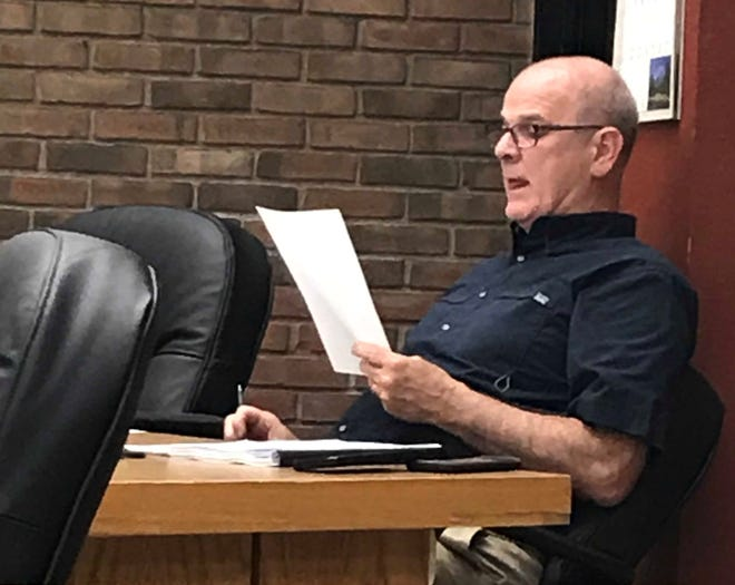 Mayor Jeff Reser reads his report to council on Tuesday night.