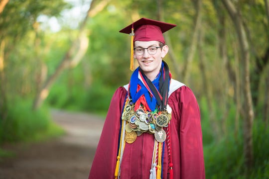 John Henry Stearns won the National Speech and Debate Association's Big Question Debate championship. Debate has always been a big part of his life, so much so that his graduation photos included debate he'd won throughout his school career.