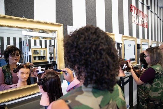 Diamond Cervantes cuts a mannequin's hair during class at the newly opened Blessed Hands Barber & Cosmetology College on Tuesday, July 2, 2019.