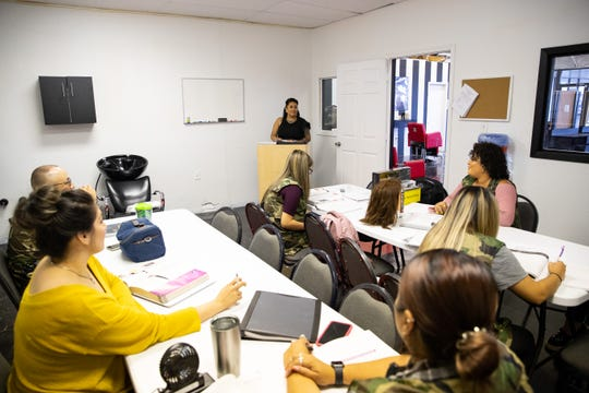 Chriselda Rodriguez leads a class at the newly opened Blessed Hands Barber & Cosmetology College on Tuesday, July 2, 2019.