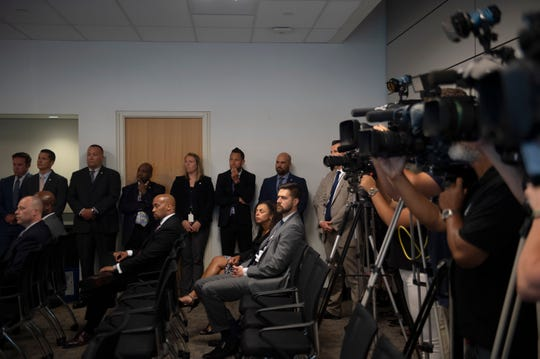 Employees from the prosecutor's office and law enforcement officials line the room as a press briefing is held announcing charges in the kidnapping and murder of Curtis Jenkins III in Camden, N.J. on Wednesday, July 3, 2019.