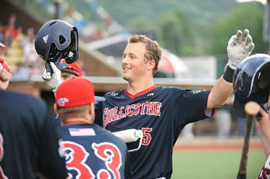 Chillicothe Paints catcher Cole Andrews celebrates hitting home run with teammates on Tuesday. The Chillicothe Paints baseball team defeated the West Virginia Miners 4-1 Tuesday night at the VA Memorial Stadium in Chillicothe, Ohio, on July 02, 2019.