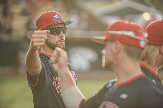 Cody Orr fist bumps teammate in a 4-1 win over West Virginia on July 2. Orr has dominated on the mound and at the plate for the Paints so far this season.