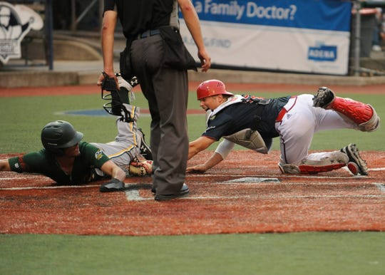 Cole Andrews tags a runner out at the plate in a 4-1 win over West Virginia on July 2. Andrews had a big year in his freshman season at Miami, now that success is carrying over to his summer with the Chillicothe Paints.