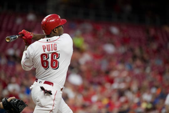 Cincinnati Reds right fielder Yasiel Puig (66) watches his home run sail out of the park in the seventh inning of the MLB baseball game against Milwaukee Brewers on Tuesday, July, 2, 2019, at Great American Ball Park in Cincinnati.