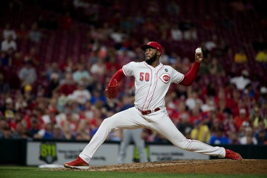Cincinnati Reds relief pitcher Amir Garrett (50) throws a pitch in the tenth inning of the MLB baseball game against the Milwaukee Brewers on Tuesday, July, 2, 2019, at Great American Ball Park in Cincinnati.
