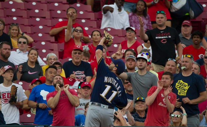 Milwaukee Brewers second baseman Mike Moustakas (11) catches a pop up in the fourth inning of the MLB baseball against the Cincinnati Reds on Tuesday, July, 2, 2019, at Great American Ball Park in Cincinnati.