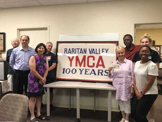 Raritan Valley YMCA board members recognize the founding of the International Y with a donation. Pictured are Charles Heppel, Ken Stout, Gina Stravic, Christopher Newcomb, Priscilla Rose, Brittni Rodriquez, Arthur Lewin and Julia Wieczorek.