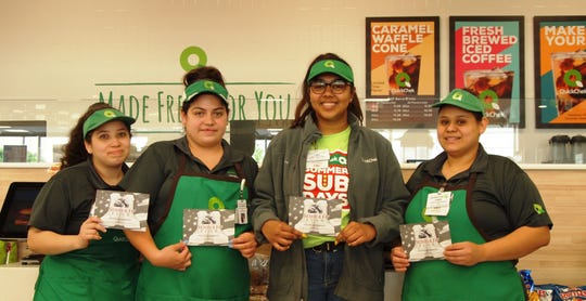 QuickChek is raising funds to help provide immediate financial assistance and lifetime support to members of the U.S. Armed Forces and their families through an in-store donation program. Customers are invited to purchase paper boots for $1 at any of the company's 158 fresh convenience market store locations. Pictured are (left to right) QuickChek team members Franshesca Flores, Raritan Store Leader Alexandra Salazar, Oma Sampal and Cindy Rincon in the company's new Raritan store.