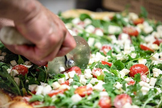 According to Mijo's owners Laura and Marty Venezio, their Arugula pizza sells the best during the summer