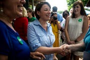 U.S. Sen. Amy Klobuchar, D-Minn, talks with people in the crowd before speaking at the West Des Moines Democrats summer picnic on Wednesday, July 3, 2019, at Legion Park in West Des Moines.