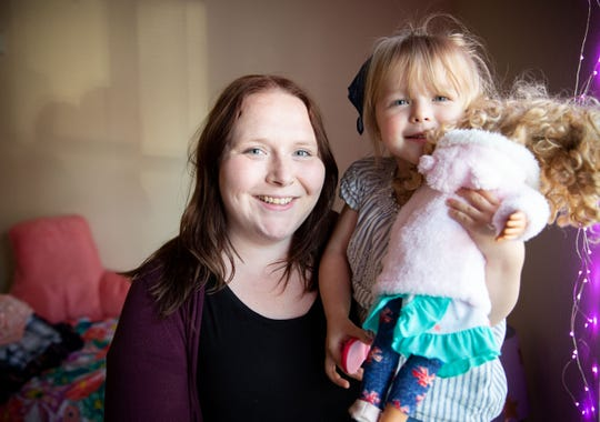 Emalie Cipale holds her daughter Harper Condo, 3, at their Des Moines Apartment Wednesday, May 15, 2019.