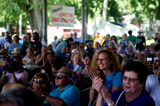 The crowd listens to presidential candidates speak at the West Des Moines Democrats' summer picnic on July 3 at Legion Park in West Des Moines.