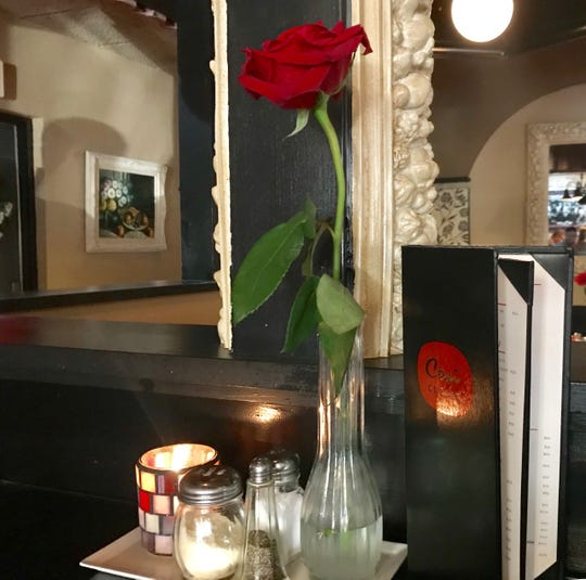 The Cosi Cucina Italian Grill features an elegant yet casual atmosphere, including a single rose and candle on each table.
