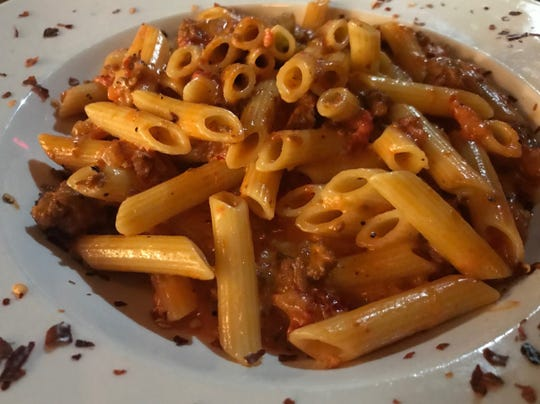 The Ziti Cucina is a signature dish of the Cosi Cucina Italian Grill, featuring Spicy Graziano's Italian Sausage, dun dried tomatoes and a zesty tomato cream sauce.