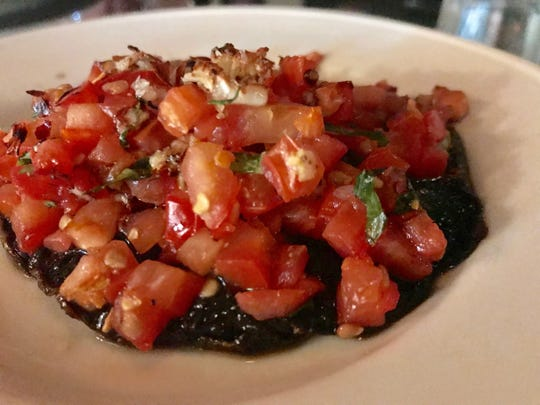 The Grilled Portabella appetizer at Cosi Cucina Italian Grill featured tomatoes and Italian spices.