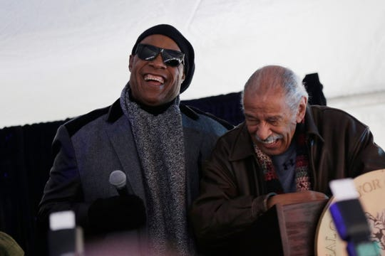 Stevie Wonder, left shares a laugh with congressman John Conyers during a ceremony for the renaming of Milwaukee Street as Stevie Wonder Avenue in Detroit on Wednesday, December 21, 2016.