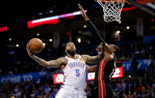 Thunder forward Markieff Morris drives to the basket against Heat center Bam Adebayo last season.