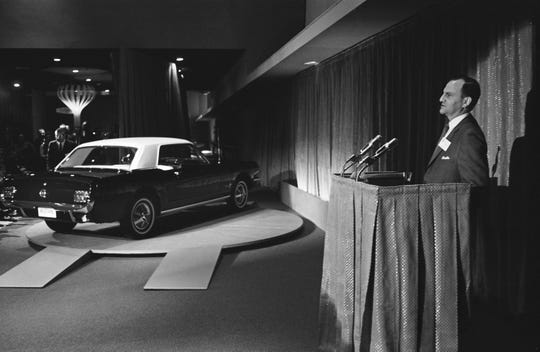 Lee Iacocca unveils the Ford Mustang at the 1964 World's Fair in New York.