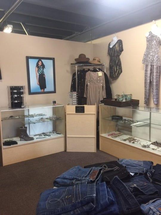 Sassy Sheek has re-opened its upscale resale shop.