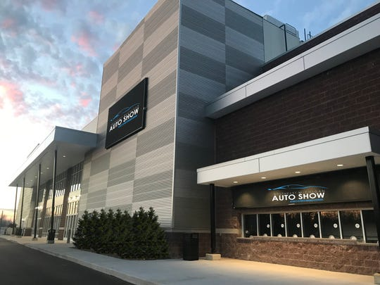 Artist's rendering of the Suburban Collection Showplace in Novi with signs for its planned January auto show.