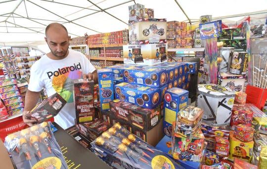 Global Dreams, Inc. owner Danny Hirmaz  sells fireworks in the parking lot of the Chesterfield Market shopping center on  Gratiot and Carriage Way in Chesterfield Twp., Wednesday morning.