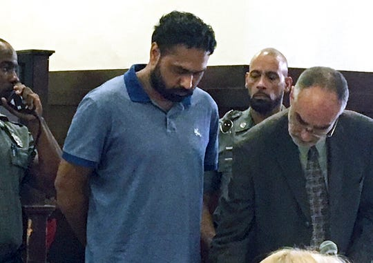 Gurpreet Singh, center, stands during arraignment on Wednesday, July 3, 2019, 2019, in Superior Court in New Haven, Conn., in connection to the deaths of four people in West Chester, Ohio in April. Singh waived extradition to Ohio and did not enter a plea.