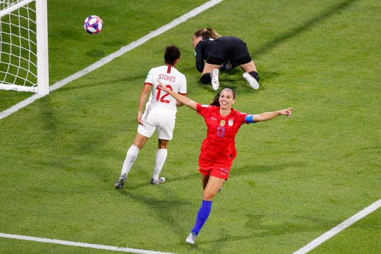 Alex Morgan scores in the semifinal against England on Tuesday.