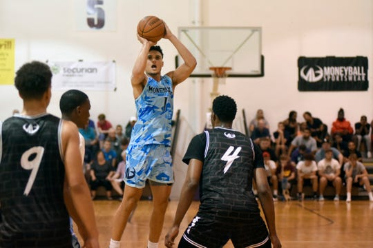 Michigan's Adrien Nunez puts up a shot during the Moneyball Pro-Am on Tuesday at Aim High Sports in Dimondale, Mich.