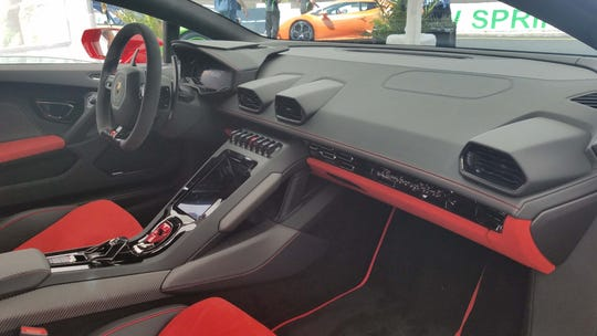 The interior of the 2020 Lamborghini Huracan EVO is less cluttered as the supercar adopts and Audi-like, console touchsreen. The fighter-jet ignition button is covered by a red shroud.