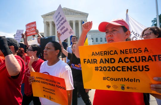 In this June 27, 2019, file photo, Demonstrators gather at the Supreme Court as the justices finish the term with key decisions on gerrymandering and a census case involving an attempt by the Trump administration to ask everyone about their citizenship status in the 2020 census, on Capitol Hill in Washington.