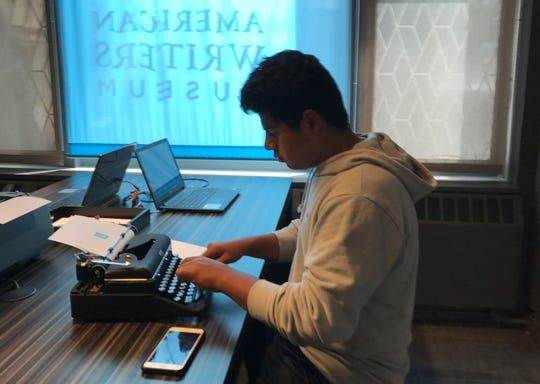A teenage visitor using a typewriter on display at the American Writers Museum in Chicago.