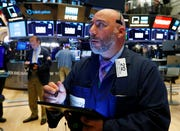 In this July 1, 2019, file photo trader Vincent Napolitano works on the floor of the New York Stock Exchange. Investors extended a rally through a holiday-shortened day and pushed the S&P 500 index to its third straight record high close on Wednesday.