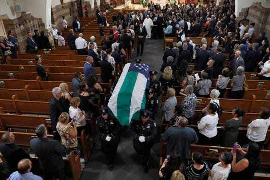 The casket of Detective Luis Alvarez is carried from Immaculate Conception Church, in the Queens borough of New York, following his funeral, Wednesday, July 3, 2019.