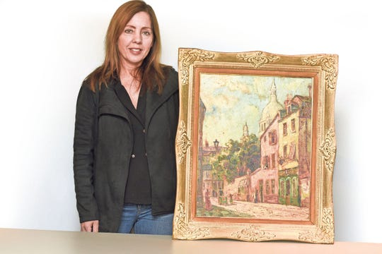 Beverly Smith with her painting, which features the Parisian neighborhood of  Montmartre.