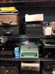 A shelf of vintage typewriters in the repair shop of the Gramercy Typewriter Co., in New York.