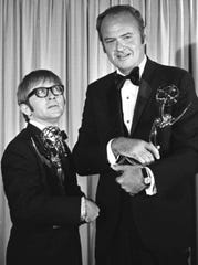 In this June 8, 1969 file photo, Harvey Korman, right, and Arte Johnson each hold their Emmys for Outstanding Individual Achievements for a Variety Performance.