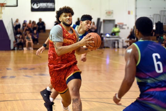 Michigan's Isaiah Livers goes to the basket on Tuesday during the Moneyball Pro-Am at Aim High Sports in Dimondale, Mich.