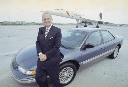 Lee Iacocca poses next to the new Chrysler Concorde with the British Airways Concorde in the background, Monday, July 13, 1992, at New York's John F. Kennedy International Airport.