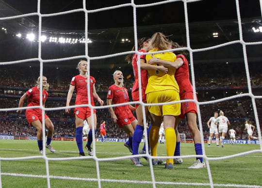 USA teammates hug goalkeeper Alyssa Naeher after she saved a penalty shot taken by England's Steph Houghton during Tuesday's semifinal.