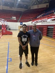 Dwayne Rose Jr. with Detroit Mercy coach Mike Davis.