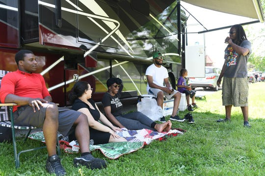 From left, family members Jawon Thompson, 21, his wife Jennifer Thompson, 21, both of Westland, Ronel Hall, 23, of Detroit, James Hall IV, Paris Tillman, 5, and James Tillman, 47, of Detroit relax on Belle Isle in Detroit on Memorial Day.