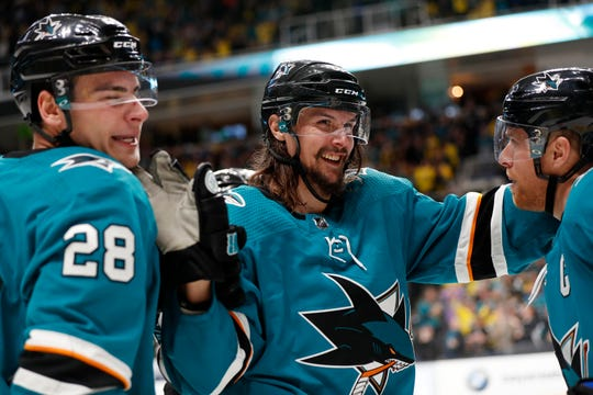 The San Jose Sharks re-signed defenseman Erik Karlsson to an eight-year deal.
