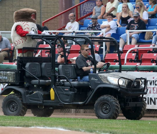 Elmira Pioneers mascot Stitches rides onto the field before a game against the Oneonta Outlaws on July 2, 2019 at Dunn Field.