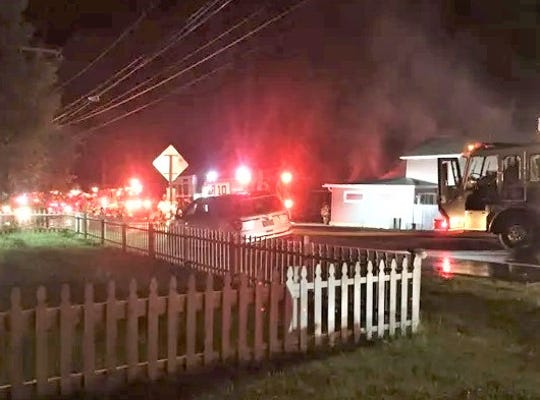 Firefighters respond to a blaze late Tuesday in the Millport area.