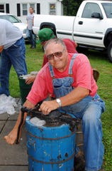 Curran Wilkinson of Midway churns ice cream for the 2012 Midway UMC ice cream social.