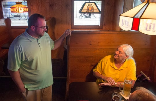 New owner Matthew Klees, left, chats with longtime patron Jo Niemeier, right, in the barroom at Kipplee's restaurant Wednesday, July 3, 2019. Klees took over the restaurant with his wife Kaycey July 1.