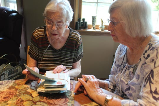 Juanita Billow, 89, of Fremont, left, and Betty Hood, 88, of Brisbane, Australia look over letters that Hood sent to Billow over the years. The women have been pen pals since 1946. This week marked Hood's second trip to the United States. Billow has also visited Hood in Australia twice.