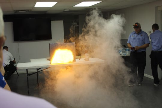 The Attack Digital Fire Training System, which produces simulated flames and real smoke, is demonstrated by the Clyde Fire Department.