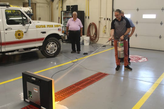 Santos Martinez, senior manager Environmental Health and Safety Direcotr for Whirlpool, puts out a digital fire with real water on Attack Digital Fire Training System.